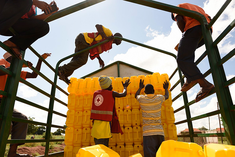Red Cross distributes jerry cans in Uganda in November 2015 in advance of predicted floods