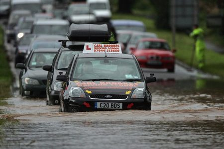 Cars driving on flooded road