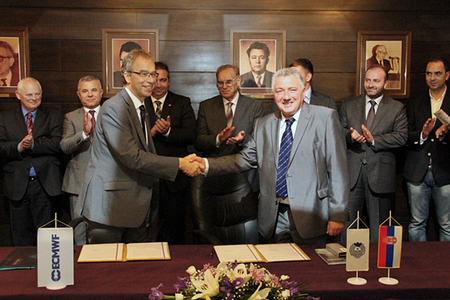 Photo of accession agreement being signed between Serbia and ECMWF