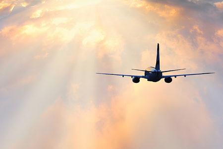 Passenger plane flying through clouds