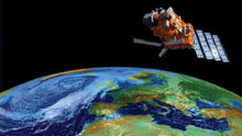 Satellite in outer space with Planet Earth on background