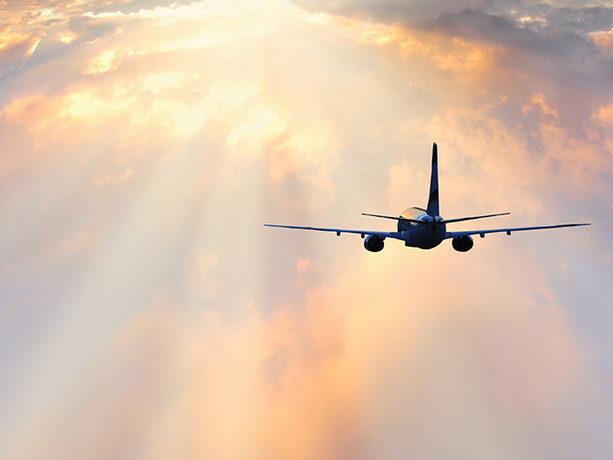 Passenger plane flying through clouds, Serjio74/iStock/Thinkstock